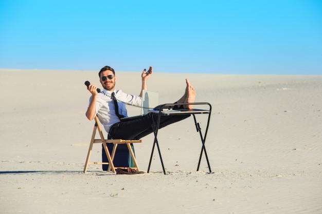 businessman-using-laptop-desert_155003-10621